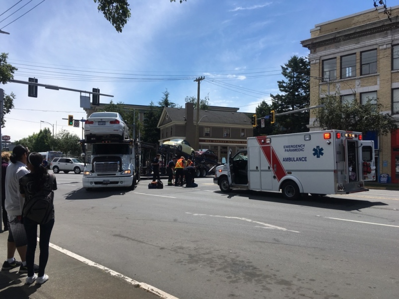 auto transport truck strikes pedestrian.jpeg
