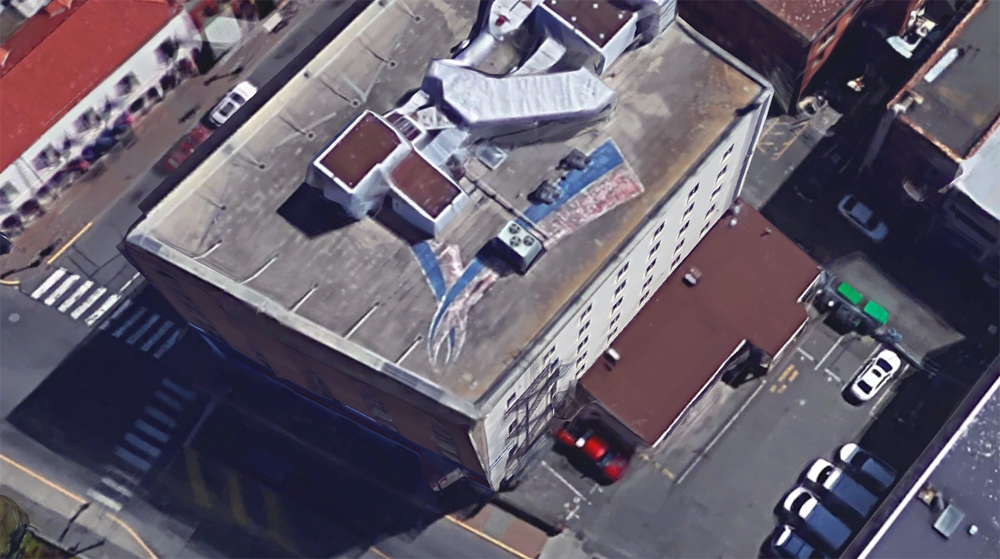 Commonwealth-Games-symble-remains-painted-on-downtown-Victoria-roof.jpg
